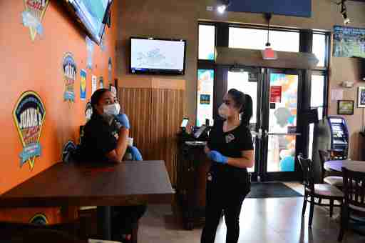 Staff of Juana's Latin Sports Bar & Grill waiting for customer to arrived for re-opens for indoor dining on May 18, 2020 in Miramar, Florida. The six year old family own restaurant with 30 plus employee re-opened approximately two months after shutting it's doors due to the coronavirus pandemic and lost over $300,000 of revenue during that time. Juana's Latin Sports Bar & Grill just received a PPP loan approval on May 6 and looking for most of they employee to come back to work. as Broward County starts the first phase of the states coronavirus pandemic re-opening plan, which includes openings with certain restrictions of businesses like barber shops, hair salon, restaurants and retail stores. (Photo by JL/Sipa USA)No Use UK. No Use Germany.