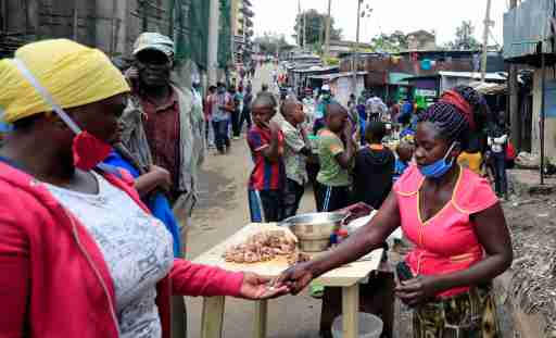 A woman sells fried chicken at her open stall along a street, amid the spread of the coronavirus disease (COVID-19) in Nairobi, Kenya April 19, 2020. REUTERS/Thomas Mukoya
