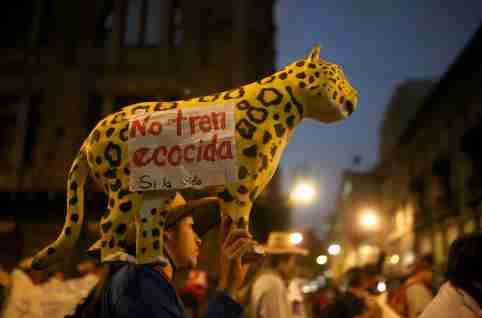 "A demonstrator holds a papier-mache jaguar with a note reading "" No ecocidal train"" as Mexico's Zapatista National Liberation Army (EZLN) protest against the construction of the Mayan train and the Santa Lucia airport projects promoted by Mexico's government in Mexico City, Mexico, February 21, 2020. REUTERS/ Edgard Garrido     TPX IMAGES OF THE DAY"