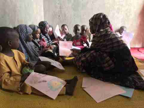 Student teacher with kids at home/school (credits: dRPC, Kano December 2019)