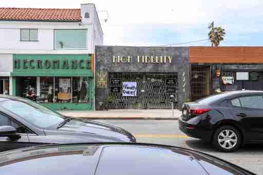 """High Fidelity, a black owned business on Melrose Avenue, displays a """"Minority Owned"""" signed in the window with hopes that their business would not be looted or damaged during the riots that took place the night before in Los Angeles, CA on Sunday, May 31, 2020. (Photo by Desmond A. Hester / Sipa USA)No Use UK. No Use Germany."""