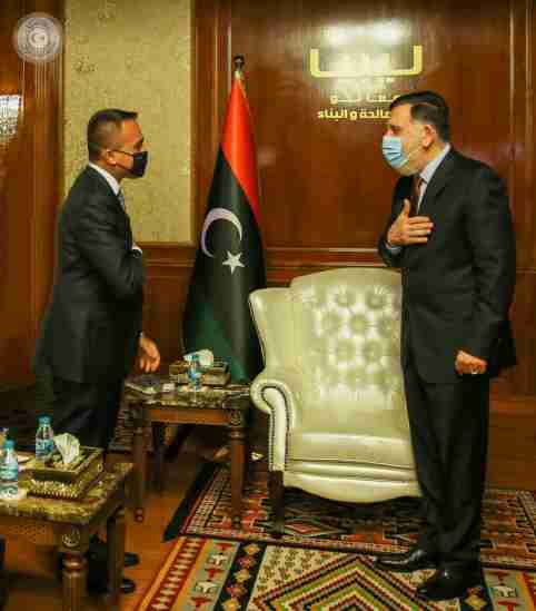 Prime Minister Fayez al-Serraj of Libya's internationally recognised Government of National Accord (GNA) wears a protective mask as he meets with Italian Foreign Minister Luigi Di Maio in Tripoli, Libya June 24, 2020. The Media Office of the Prime Minister/Handout via REUTERS ATTENTION EDITORS - THIS IMAGE WAS PROVIDED BY A THIRD PARTY.