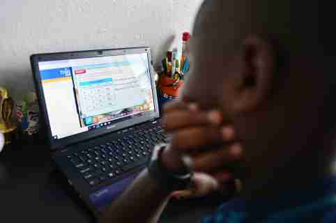 9 year old student Jordan in his bedroom in front of his laptops during distance virtual school learning amid Coronavirus Pandemic in Broward County, Florida Public Schools. Florida began their experience with online virtual distance learning, amid the growing coronavirus pandemic on March 31, 2020 in Miramar, Florida.   (Photo by JL/Sipa USA)No Use UK. No Use Germany.