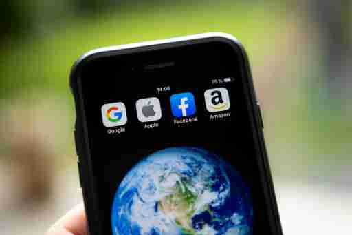 Acronym GAFA (Google, Apple, Facebook, Amazon) designed on an iPhone screen. Montreal (Canada), July 28th, 2019.Sigle GAFA (Google, Apple, Facebook, Amazon) forme avec les icones des applications mobiles. Montreal (Canada), le 28 juillet 2019.NO USE FRANCE