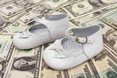 Baby shoes on top of money