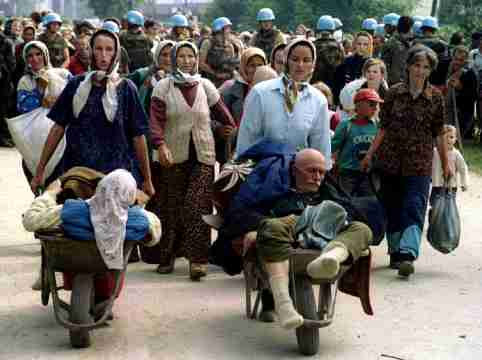 FILE PHOTO: Group of Bosnian refugees from Srebrenica, walk to be transported from eastern Bosnian village of Potocari to Kladanj near Olovo, July 13, 1995. Bosnia will mark the 25th anniversary of the massacre of more than 8,000 Bosnian Muslim men and boys on July 11, 2020, with many relatives unable to attend due to the novel coronavirus pandemic.  REUTERS/Stringer/File Photo