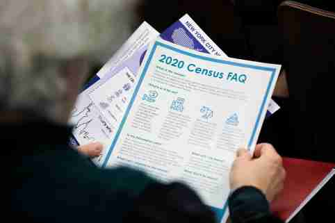A person holds census information at an event where U.S. Rep. Alexandria Ocasio-Cortez (D-NY) spoke at a Census Town Hall at the Louis Armstrong Middle School in Queens, New York City, U.S., February 22, 2020. REUTERS/Andrew Kelly