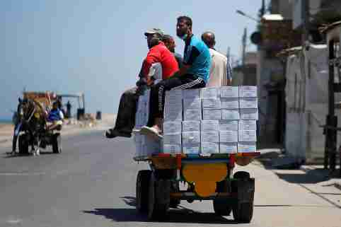 Palestinians ride a horse-drawn cart transporting aid supplies distributed by UNRWA at Beach refugee camp amid the coronavirus disease (COVID-19) crisis, in Gaza City June 1, 2020. REUTERS/Mohammed Salem