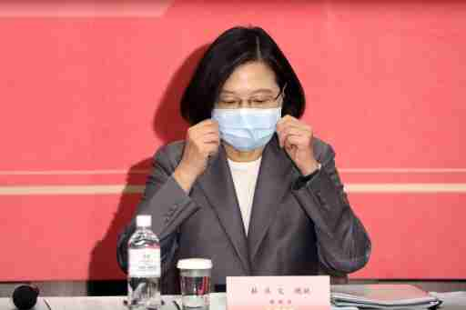 Taiwan's President Tsai Ing-wen adjusts her face mask to prevent the spread of the coronavirus disease (COVID-19) at The Third Wednesday Club, a high-profile private industry trade body in Taipei, Taiwan, August 19, 2020. REUTERS/Ann Wang
