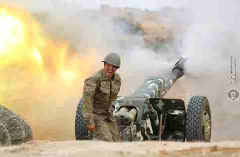 An ethnic Armenian soldier fires an artillery piece during fighting with Azerbaijan's forces in the breakaway region of Nagorno-Karabakh, in this handout picture released September 29, 2020. Defence Ministry of Armenia/Handout via REUTERS  ATTENTION EDITORS - THIS IMAGE HAS BEEN SUPPLIED BY A THIRD PARTY. NO RESALES. NO ARCHIVES. MANDATORY CREDIT. PICTURE WATERMARKED AT SOURCE.     TPX IMAGES OF THE DAY