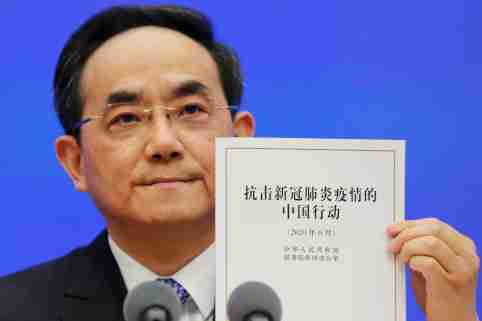 Xu Lin, vice head of the publicity department of the Communist Party of China (CPC) Central Committee, holds a copy of the white paper about China's fight against the coronavirus disease (COVID-19) during a State Council Information Office (SCIO) briefing in Beijing, China June 7, 2020.  REUTERS/Florence Lo