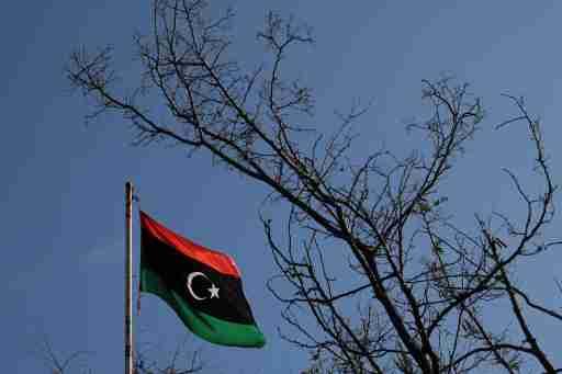 A Libyan flag flutters atop the Libyan Consulate in Athens, Greece, December 6, 2019. REUTERS/Costas Baltas