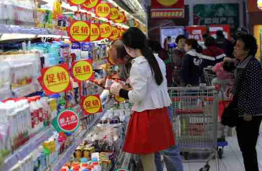 "--FILE--Customers shop for dairy products due to discounts at a supermarket in Nanjing city, east China's Jiangsu province, 16 October 2017.Consumers who are anticipating cheaper prices for products during the upcoming Nov 11 shopping festival may not necessarily find them online, a new study said. According to the 2017 China shopping report jointly released by market consultancies Bain & Co and Kantar Worldpanel, the online prices of many product categories are higher than those offered in physical stores, with the biggest price differences seen for toothbrushes, hair conditioners and kitchen cleansing supplies. Jason Yu, general manager of Kantar Worldpanel for Greater China, said the price differences can be largely attributed to the fact that relatively more high-end products are purchased online. ""While Chinese consumers used to shop online for low prices in the past, it has been increasingly noticeable in the recent five years that people prefer products that indicate a better lifestyle or entail more added value,"" he said. As a result, the sales of imported goods, especially food products and personal care products, have risen significantly, he said. ""To cater to this trend, leading e-commerce players such as Alibaba and JD.com have upgraded their offerings on their platforms to meet the demand of the rising middle class and younger consumers,"" he said.No Use China. No Use France."