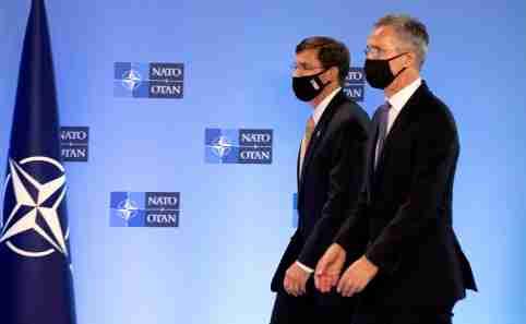 NATO Secretary General Jens Stoltenberg walks with U.S. Secretary of Defense Mark Esper prior to a news conference at NATO headquarters in Brussels, Belgium June 26, 2020. Virginia Mayo/Pool via REUTERS