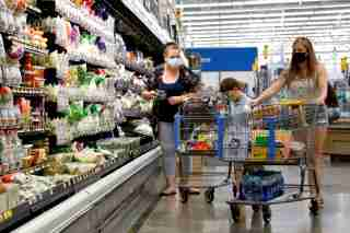 FILE PHOTO: Shoppers are seen wearing masks while shopping at a Walmart store in Bradford, Pennsylvania, U.S. July 20, 2020. REUTERS/Brendan McDermid/File Photo/File Photo