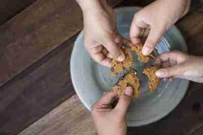 People splitting a cookie