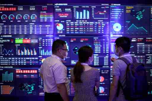 People visit a booth during the Huawei Connect conference in Shanghai, China.