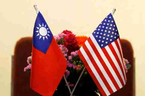 FILE PHOTO: Flags of Taiwan and U.S. are placed for a meeting In Taipei, Taiwan March 27, 2018. REUTERS/Tyrone Siu/File Photo