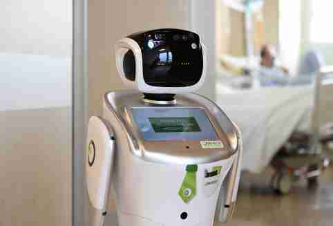 A robot helping medical teams treat patients suffering from the coronavirus disease (COVID-19) is pictured at the corridor, in the Circolo hospital, in Varese, Italy April 1, 2020. REUTERS/Flavio Lo Scalzo