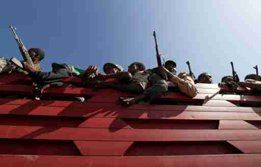 FILE PHOTO: Members of Amhara region militias ride on their truck as they head to the mission to face the Tigray People's Liberation Front (TPLF), in Sanja, Amhara region near a border with Tigray, Ethiopia November 9, 2020. REUTERS/Tiksa Negeri//File Photo