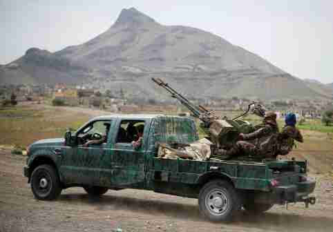 Houthi fighters man a machine gun mounted on a military truck as they parade during a gathering of Houthi loyalists on the outskirts of Sanaa, Yemen July 8, 2020. REUTERS/Khaled Abdullah