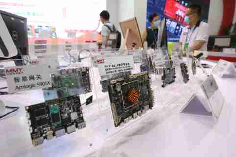 Semiconductor products are displaeyd on a white table at a conference in eastern China.