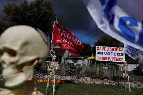 Halloween decorations and support for U.S. President Donald Trump are seen in the front of supporter Maranda Joseph's yard in Warren, Ohio, U.S., October 2, 2020. REUTERS/Shannon Stapleton