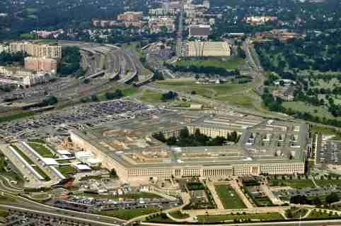 Photo: Aerial of the Pentagon, the Department of Defense headquarters in Arlington, Virginia, near Washington DC, with I-395 freeway on the left, and the Air Force Memorial up middle.