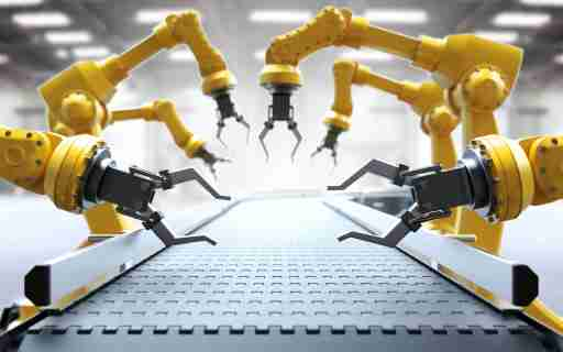 Robotic arms in a factory.