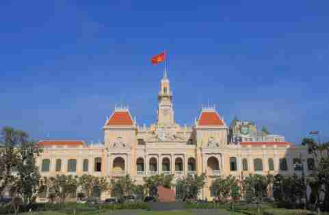 Government building city hall Vietnam with flag flying