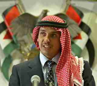 FILE PHOTO: Jordan's Crown Prince Hamza bin Hussein delivers a speech to Muslim clerics and scholars at the opening ceremony of a religious conference at the Islamic Al al-Bayet University in Amman, Jordan August 21, 2004. REUTERS/Ali Jarekji/File Photo