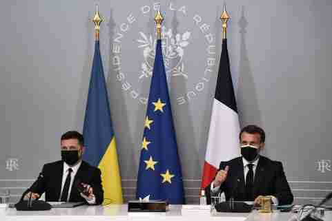 French President Emmanuel Macron and Ukrainian President Volodymyr Zelenskiy hold a news conference following their meeting at the Elysee Palace in Paris, France April 16, 2021. Anne-Christine Poujoulat/Pool via REUTERS