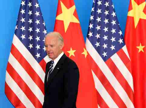 """U.S. Vice-President Joe Biden arrives with his Chinese counterpart Xi Jinping (not pictured) at a China-US Business Dialogue in the Beijing Hotel in Beijing August 19, 2011. China and the United States """"have a responsibility to strengthen macro-economic policy coordination and together boost market confidence,"""" Xi told visiting Biden on Thursday, according to Chinese state media. REUTERS/How Hwee Young/Pool (CHINA - Tags: POLITICS)"""
