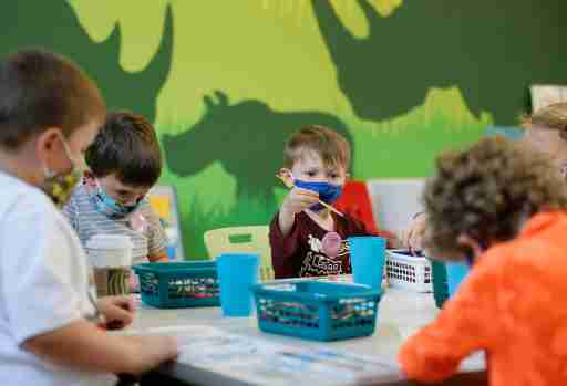 A group of kids in the Little Explorers Club, a preschool class for kids aged three to five years old, including Samuel Campbell, paint a bird scene during arts and crafts time in the Suzie Edwards Conservation Education Classrooms at the Columbus Zoo and Aquarium on Thursday, April 22, 2021.Columbus Zoo Little Explorers