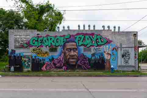 A mural of George Floyd is seen on a wall in his hometown of Third Ward, TX.