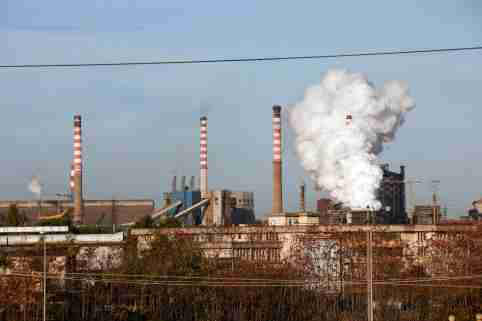 FILE PHOTO: Steam comes out of the chimneys of the Ilva steel plant in Taranto, Italy, November 11, 2019. REUTERS/Ciro De Luca/File Photo