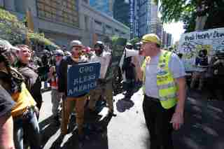 A man confronts Trump supporters with a contingent of far-right sympathizers as they rally in the street outside the Justice Center in Portland, Ore., on August 22, 2020. (Photo by Alex Milan Tracy/Sipa USA)No Use UK. No Use Germany.