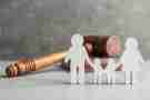 family cutout in front of a gavel