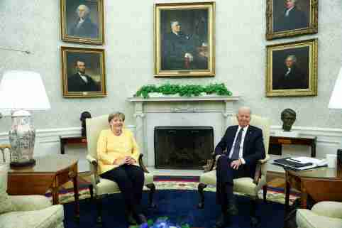 U.S. President Joe Biden holds a bilateral meeting with German Chancellor Angela Merkel in the Oval Office at the White House in Washington, U.S., July 15, 2021. REUTERS/Tom Brenner