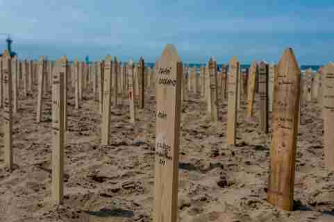On the day of 'World Refugee Day,' people across Europe commemorate the 44,000+ victims who died on European borders in the past years. On the beach of Scheveningen, in The Hague, a pop-up memorial monument was placed close to the sea to pay the last respect to the victims. The memorial monument consisted of 44,000 memorial signs out of wood sticking out of the sand on the beach with the names of the victims written on them. (Photo by /Sipa USA)