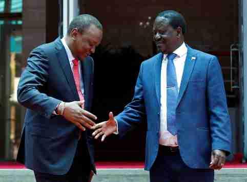 Kenya's President Uhuru Kenyatta (L) greets opposition leader Raila Odinga of the National Super Alliance (NASA) coalition after addressing a news conference at the Harambee house office in Nairobi, Kenya March 9, 2018. REUTERS/Thomas Mukoya