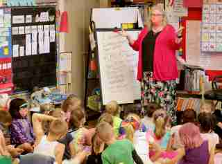 Jenny Doss, an early childhood special education teacher at Ben Franklin Elementary School, works with her K-5 class at the school in Menomonee Falls on  June 8. Doss is speaking out against Republican lawmakers' spending proposal, which only calls for a slight boost in special education funding.MJS-special education funding00p1