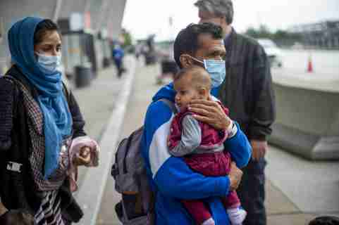 Refugees evacuated from Afghanistan arrive at Washington Dulles International Airport and make their way to a waiting bus in Chantilly, VA, USA, Wednesday, September 1, 2021. Photo by Rod Lamkey/CNP/ABACAPRESS.COM