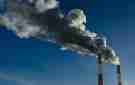 Two factory stacks emitting pollution into the air