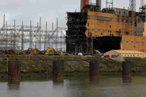"""The Tanners Creek Generating Station, a former 1000 MW, coal-fired electrical plant, is being taken down along the Ohio River in Lawrenceburg, Indiana, U.S., September 14, 2017. The plant was shut down in 2015. REUTERS/Brian Snyder  SEARCH """"SNYDER BARGES"""" FOR THIS STORY. SEARCH """"WIDER IMAGE"""" FOR ALL STORIES."""