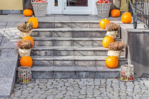 Front steps of Brooklyn home decorated for fall.