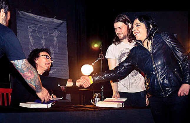 "Tony Iommi of Black Sabbath signs copies of his book ""Iron Man"" at Saint Vitus. Photo: Brooklyn Vegan"