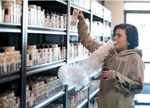 Emily Ward picks out vape E-Liquids while working last week at the Jvapes E-Liquid store in Colorado Springs.