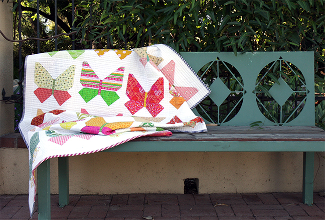 Butterfly quilt on bench