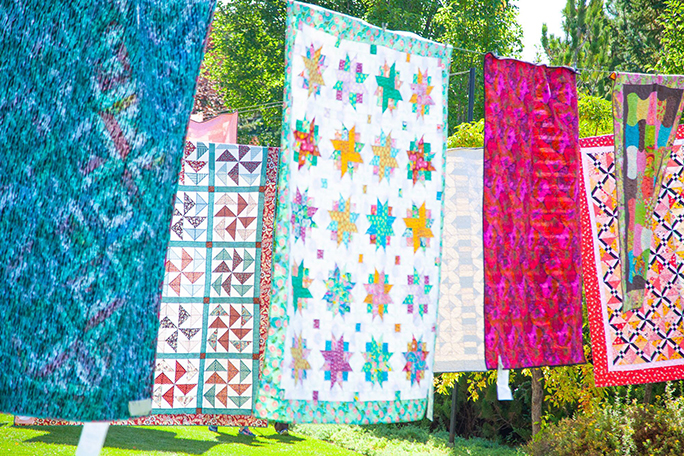 Quilts hanging in the Garden of Quilts